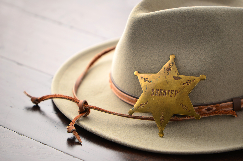 Cowboy hat and sheriff's badge