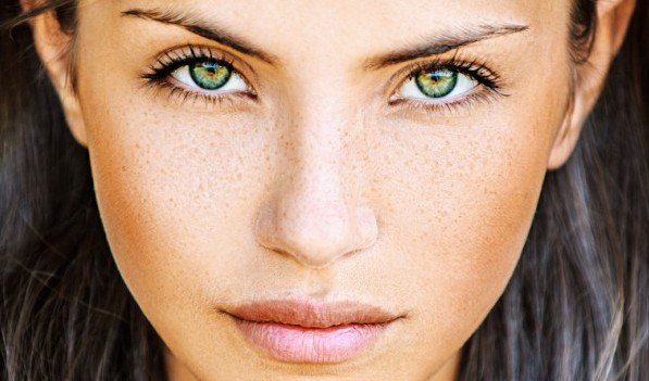 Green eyes and freckles
