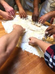 hands group baking together