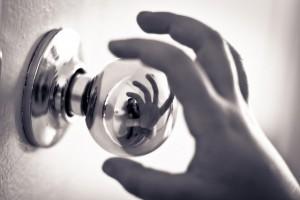 hand reaching for doorknob