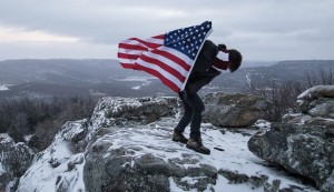 flag carried up mountain