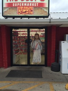 You mean a painting of Jesus and a prayer for Divine Mercy on the door to a local meat shop is uncommon?
