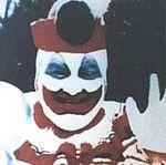 Gacy dressed as Pogo the Clown.