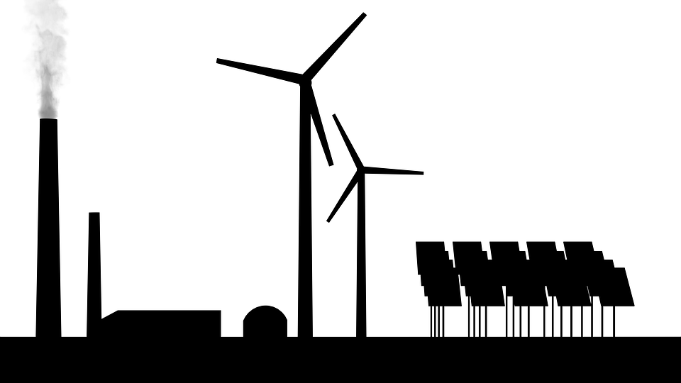 Silhouettes of three energy sources: A coal plant, windmills, and solar panels