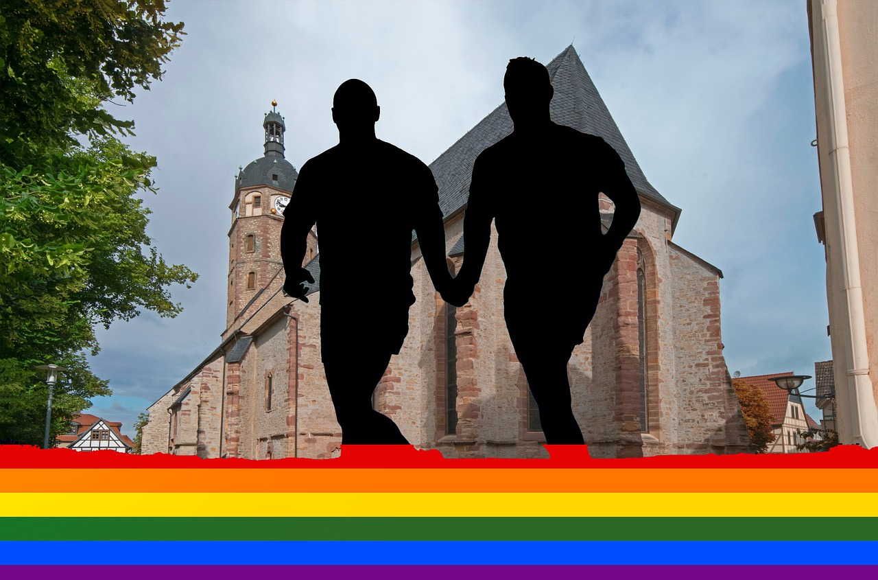 The silhouettes of two male figures standing on a rainbow, with a church background behind them.