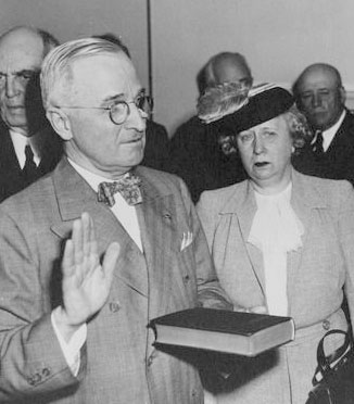 President Truman with his hand on the Christian Bible - taking the oath of office as the 33rd President of the U.S. on April 12, 1945.