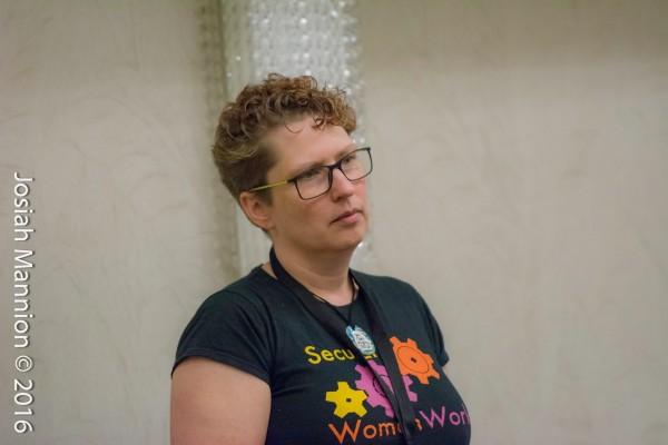 Monette listening to Skepticon 9 workshop participant (photo Josiah Mannion, Biblename Photo)