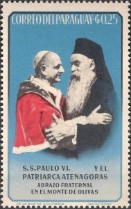 (A Paraguayan stamp, celebrating the historic 1964 meeting between Pope Paul VI and Ecumenical Patriarch Athenagoras. Source: Wikimedia, Creative Commons License).