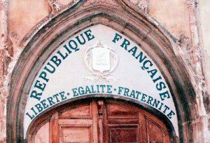 (The tympanum of a church in Aups, France, painted with the motto of the French Republic. Source: Wikimedia, Creative Commons License).
