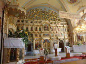 (The iconostasis of a Greek Slovak Catholic church in the village of Koroml'a, Slovakia. Source: Wikipedia, Public Domain)