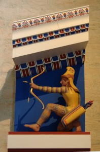 Polychrome small-scale model of the archer XI of the west pediment of the Temple of Aphaia, ca. 505–500 BC. By Bibi Saint-Pol, own work, 2007-02-08 See page for author [Public domain], via Wikimedia Commons
