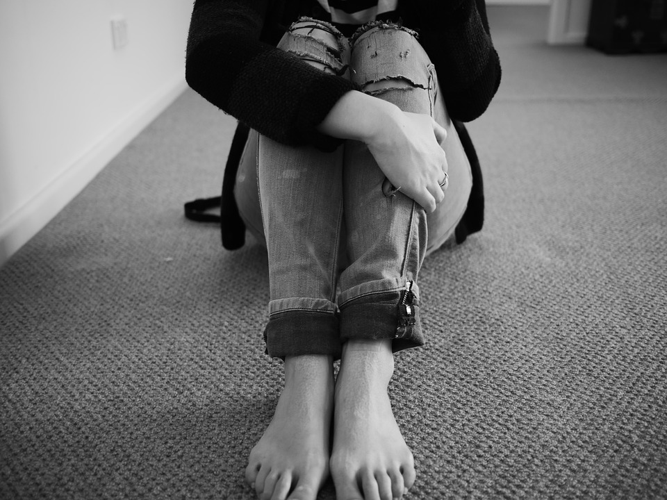 Woman Vulnerable Black And White Ripped Jeans Alone