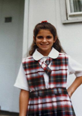 The author in her Catholic school uniform, maybe 4th-5th grade.