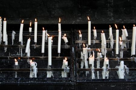 an array of candles burning