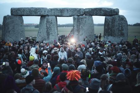 large gathering of people at stonehenge