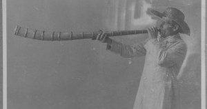 Karjapasunamängija (I believe a type of shepherd's horn) from Estonia. Photo from the Estonian History Museum, around 1920. In public domain in the U.S.