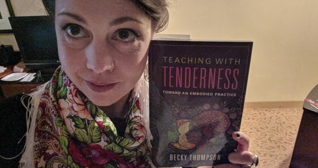 Selfie with a conference purchase, Teaching with Tenderness, a book that's been giving me great ideas to implement in the classroom.