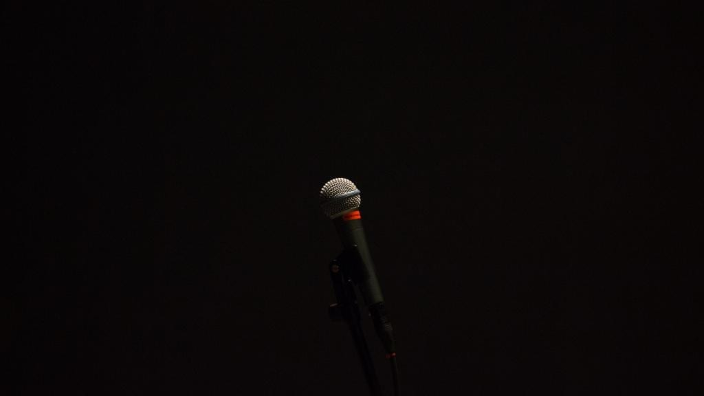 Microphone against a dark background.