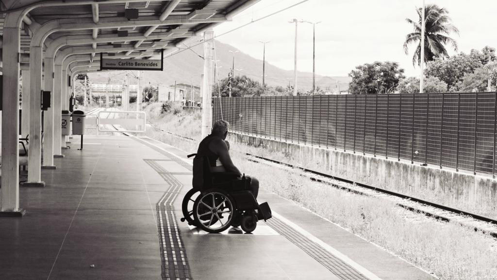 man in a wheelchair, at a metro station