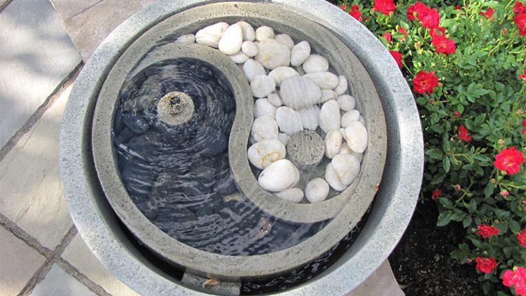 yin yang symbol made of small, smooth stones