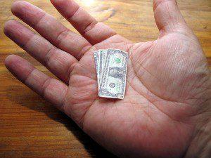 "Photo attribution: ""The Shrinking Dollar"" By frankieleon; CC 2.0"