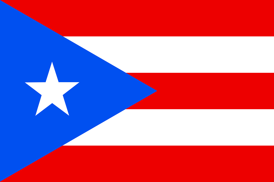 The flag of Puerto. It still waves high and mighty even after a hurricane and a President who doesn't care about it or the people it represents.