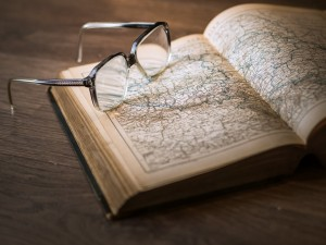 "When I typed in ""history"" into Pixabay I got this image. So for a post about atheist history, have a photo of a book of maps with glasses on top of it. Fitting enough I suppose."