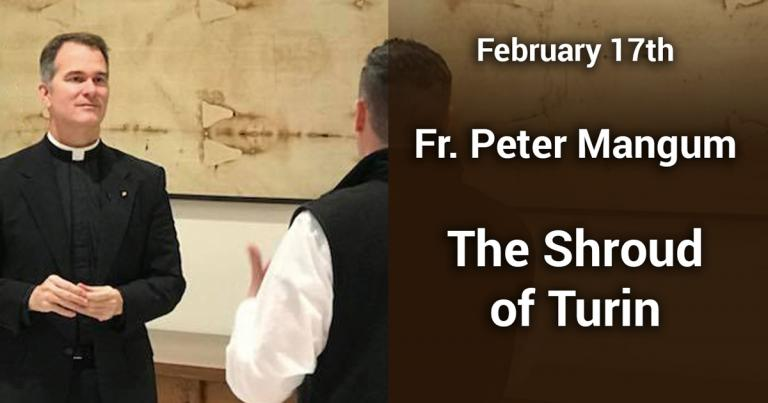 Fr. Peter in front of a replica of the Shroud of Turin