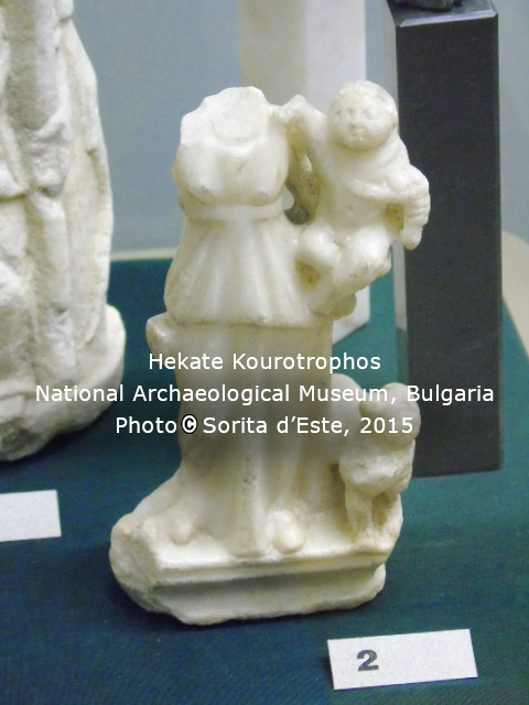 Hekate holding a baby, similar to images of Isis holding Horus