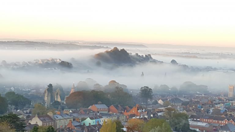 Glastonbury Abbey and Wearyall Hill, through the Mists of Avalon. Photo by Sorita d'Este, 2018