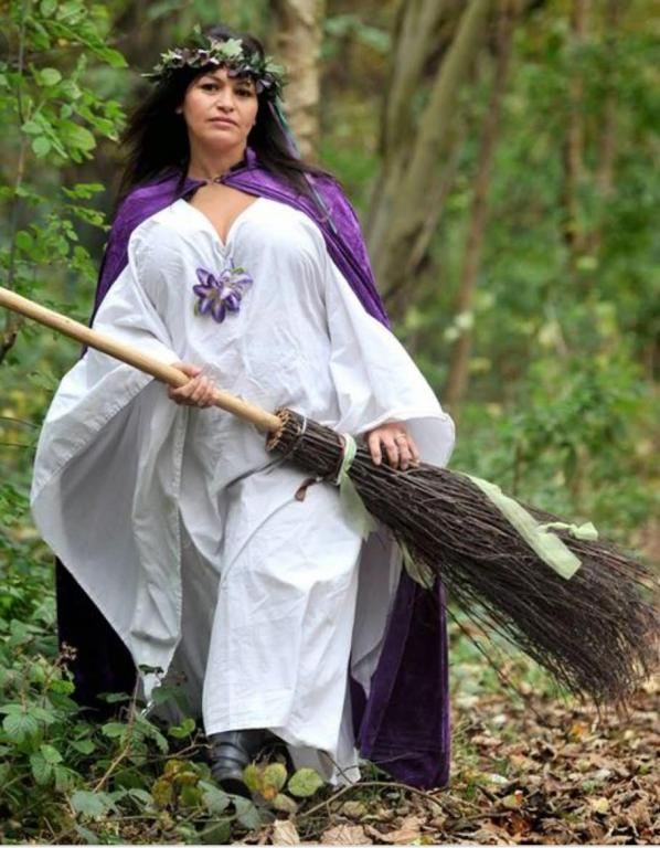Inbaal, in her Witches' Robes and Broomstick (Besom) - She practices Witchcraft
