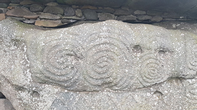 Carving of spirals on New Grange, Ireland. Photo by Sorita d'Este, February 2019