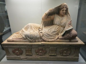 As the Etruscans were continually defeated by the Romans, their funerary art became more grim. But note that this sarcophagus shows two distinctive elements, It honors a woman (nearly unheard of in Greek culture) and she is unveiled. Image credit.