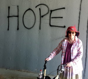 Photo next to an apt graffiti, taken on a rehab walk almost a year to the day after my awakening.
