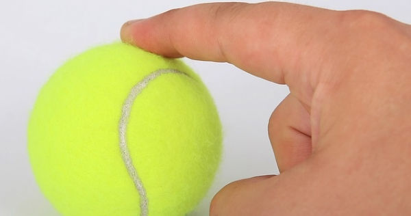 Pointing to tennis ball--cropped