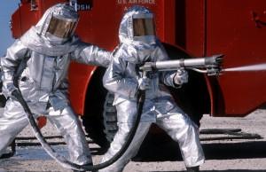 Firefighters in hazmat suits