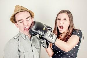Woman punchin man