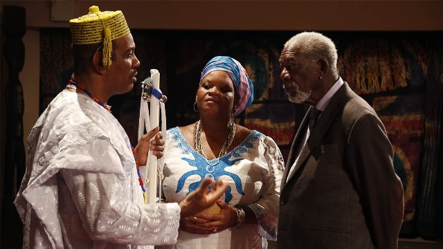 A Babalawo and priestess-in-training explain Ifa divination to Morgan Freeman