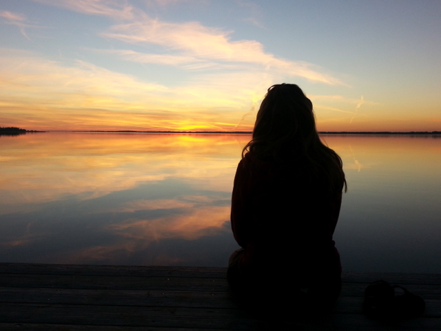 sunset-with-single-woman-silhouette