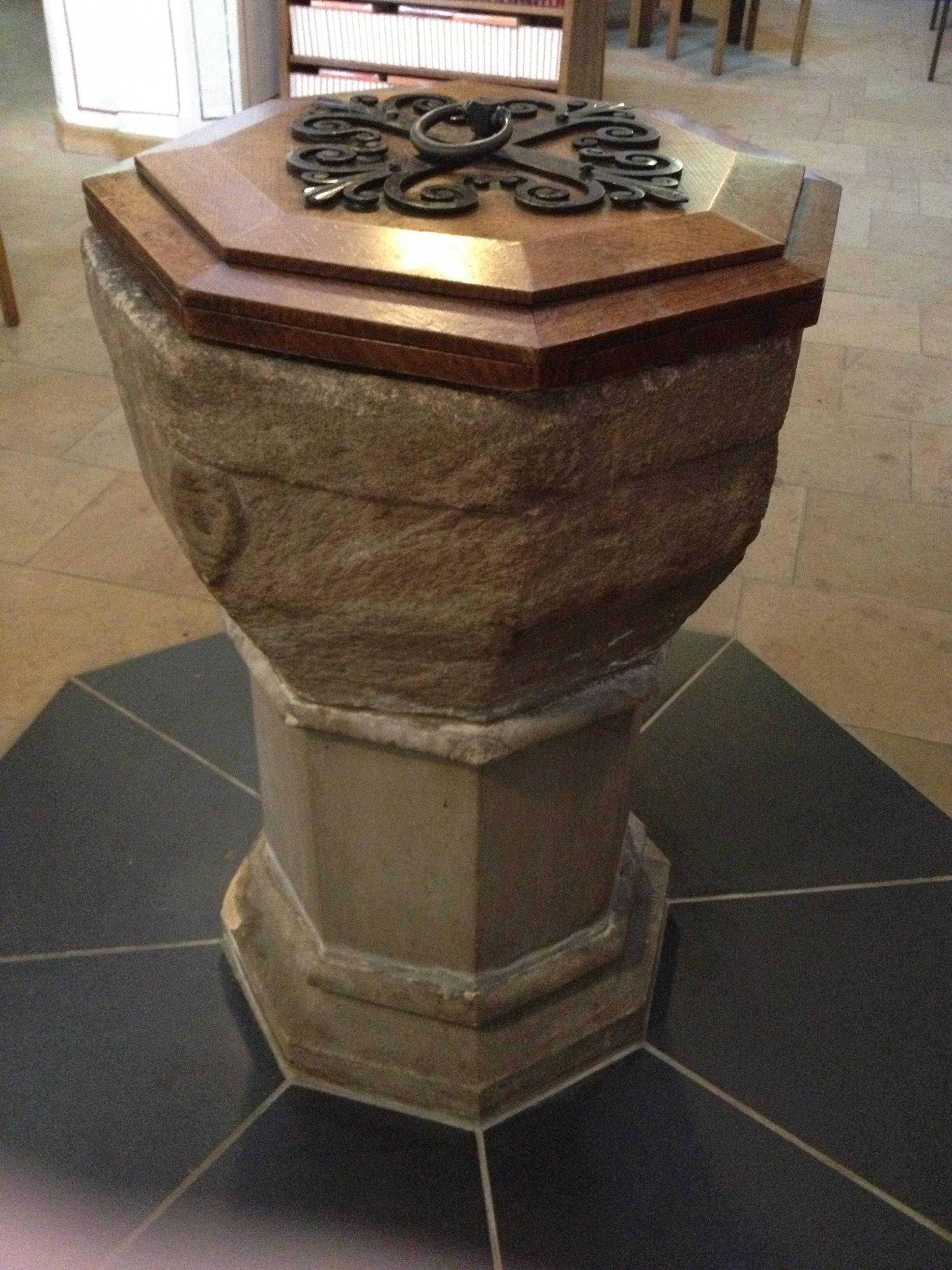 A twelfth century baptismal font from a church in the Peak District. Photo by David Russell Mosley