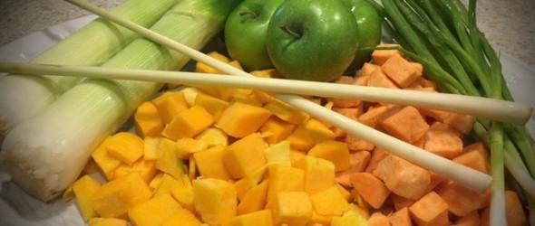 Platter with leeks, lemongrass, apples, butternut squash, sweet potatoes and green onions