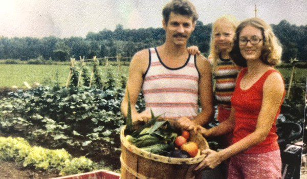 Heron and her parents in their vegetable garden, 1979