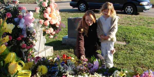 With my daughter by my mother's grave, a few days after the funeral. March, 2007