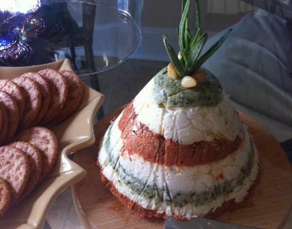 """Deck the Halls"" Sun-dried tomato, pesto and cream cheese torta with crackers. Photo by Heron Michelle"