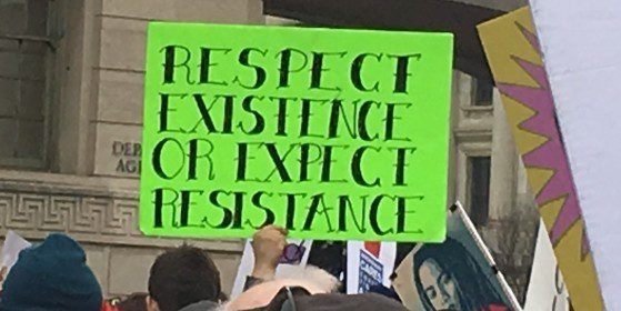 Protest sign reads respect existence or expect resistance