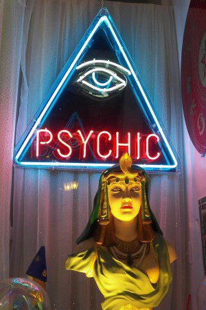 """Shop window with neon sign that reads """"Psychic"""""""