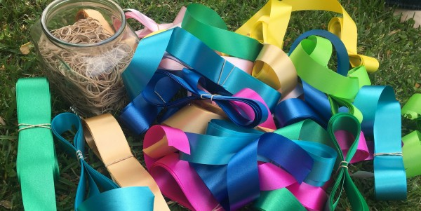 Cut, rolled, and rubber-banded ribbons, ready to be charged and added to the topper.