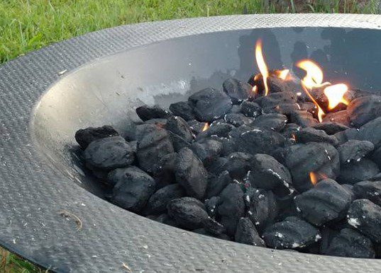 Charcoal in Fire Pit prepared for our corn roasting magick