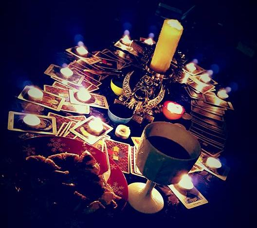 Tealight candles glow on Tarot Cards at Yule Ritual