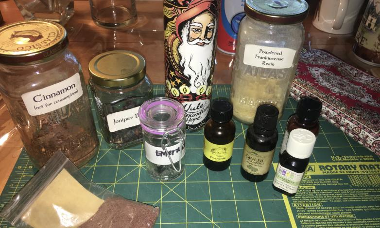 "Ingredients for dressing the candle for Yule intention of ""Rekindling Hope."" - Witch on Fire"